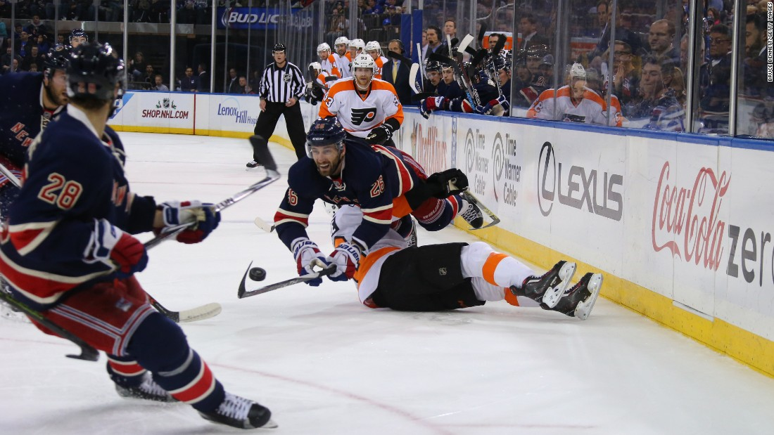 Jarret Stoll of the New York Rangers falls over Chris VandeVelde of the Philadelphia Flyers during an NHL game in New York on Saturday, November 28.