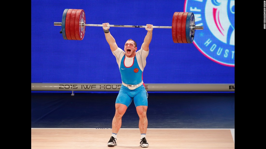 Russian weightlifter Artem Okulov rejoices Wednesday, November 25, during the Weightlifting World Championships in Houston. Okulov won gold in his weight class of 85 kilograms (187 pounds).