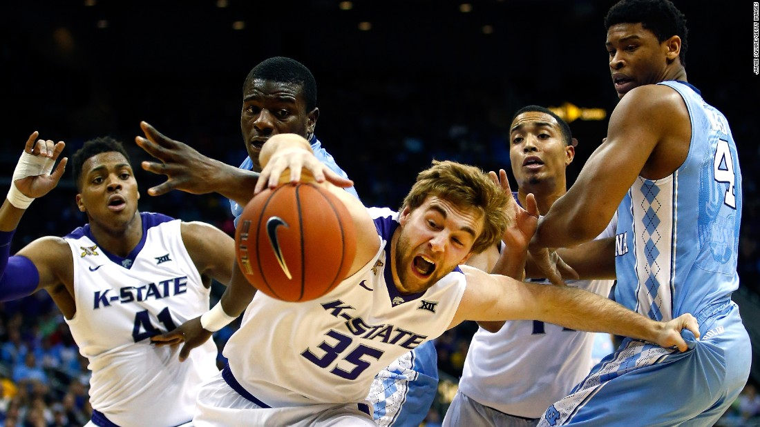Kansas State's Austin Budke lunges for a loose ball while playing North Carolina in a college basketball game played Tuesday, November 24, in Kansas City, Missouri.