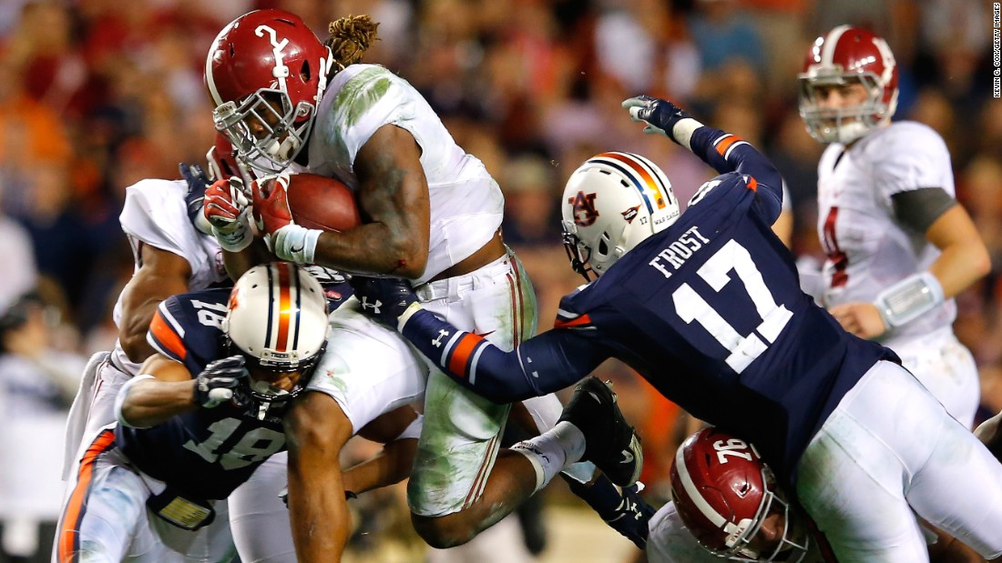 Alabama running back Derrick Henry blasts through Auburn defenders during the Iron Bowl rivalry game on Saturday, November 28. Henry ran for 271 yards and a touchdown as the Crimson Tide won 29-13 in Auburn, Alabama.