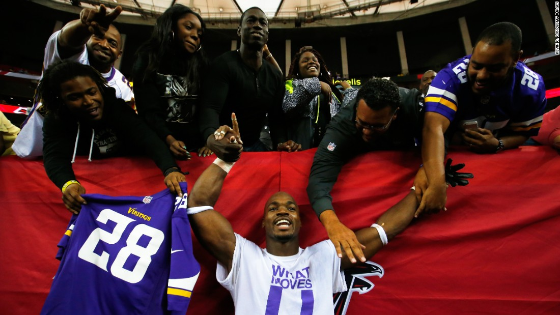 Adrian Peterson celebrates with fans in Atlanta after he and the Minnesota Vikings defeated the Atlanta Falcons 20-10 in an NFL game Sunday, November 29.