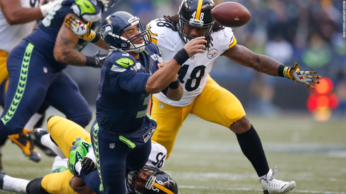 Seattle quarterback Russell Wilson is sacked by Pittsburgh's Jarvis Jones during an NFL game in Seattle on Sunday, November 29. Wilson threw five touchdowns, however, to help lead the Seahawks to a 39-30 victory.