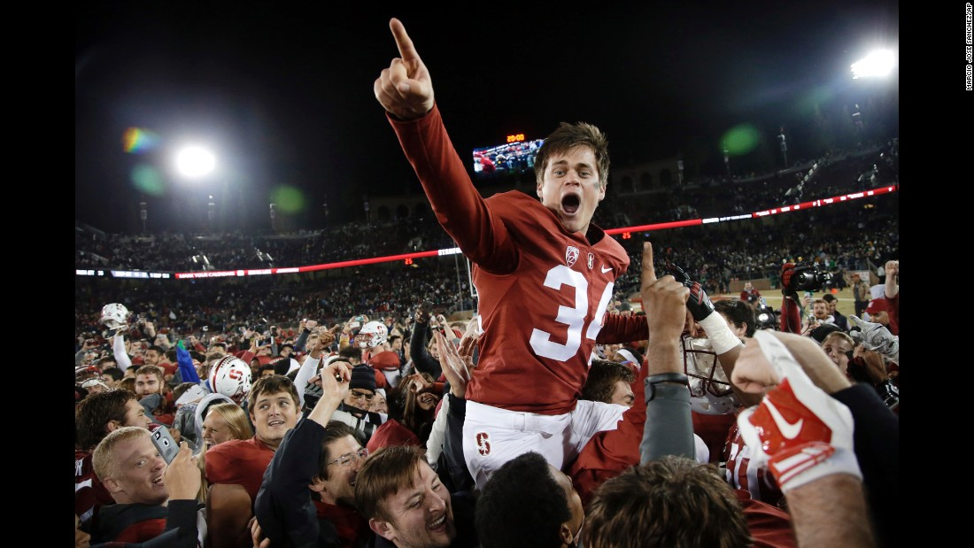 Stanford kicker Conrad Ukropina is carried off the field Saturday, November 28, after his 45-yard field goal defeated Notre Dame 38-36 in Stanford, California.