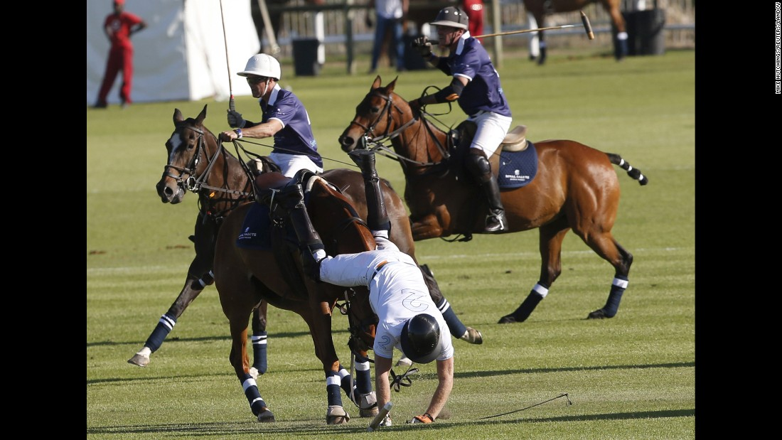 Britain's Prince Harry falls off his horse during a polo match in Paarl, South Africa, on Saturday, November 28.