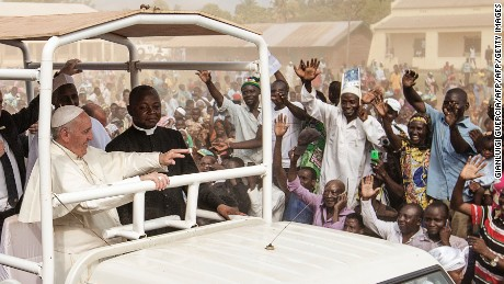 Pope Francis waves as he visits the Koudoukou school after leaving the Central Mosque in Bangui, Central African Republic on November 30.