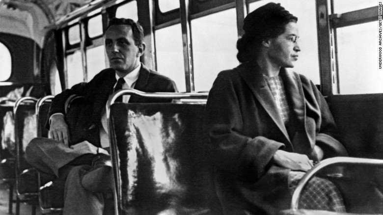"""Rosa Parks <a href=""""http://www.cnn.com/2010/US/12/01/rosa.parks.anniversary/index.html"""">became one of the major symbols of the civil rights movement</a> after she was arrested in Montgomery, Alabama, for refusing to give up her seat to a white passenger in 1955. For 381 days, African-Americans boycotted public transportation to protest Parks' arrest and, in turn, segregation laws. The boycott led to a Supreme Court ruling desegregating public transportation in Montgomery. In this photo, Parks rides the bus a day after the Supreme Court ruling in 1956."""