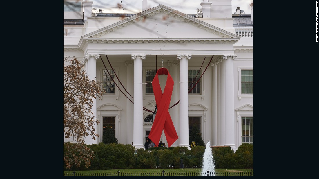 A giant red ribbon is hung on the front of the White House on World Aids Day, on December 1, 2014.