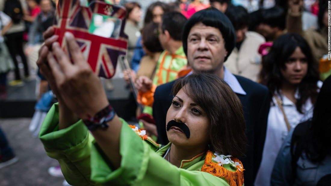 A woman in Mexico City takes a selfie Saturday, November 28, during an attempt to set a Guinness World Record for most people dressed as the Beatles. The previous record was 250. Mexico City's final count of 294 still had to be validated.