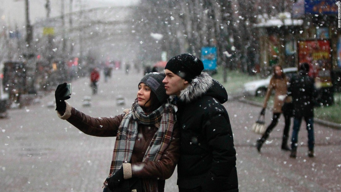 A young couple takes a selfie in Kiev, Ukraine, on Tuesday, December 1.