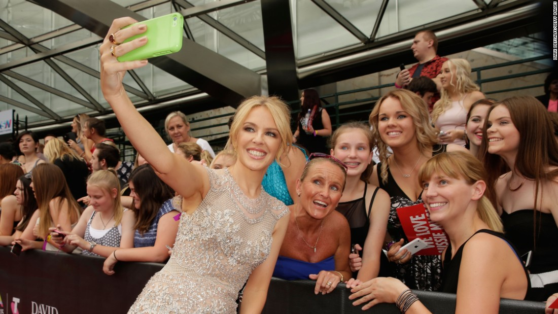 Singer Kylie Minogue takes a red-carpet selfie with fans before the ARIA Awards in Sydney on Thursday, November 26.
