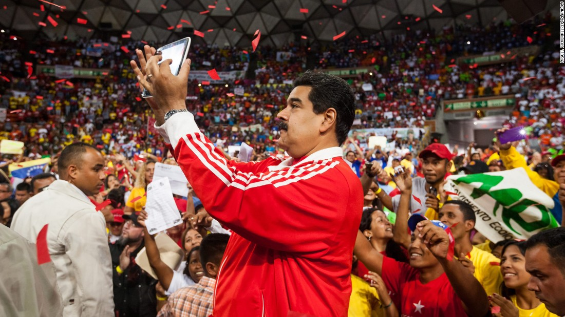 Venezuelan President Nicolas Maduro takes a selfie at an event in Caracas on Monday, November 30.