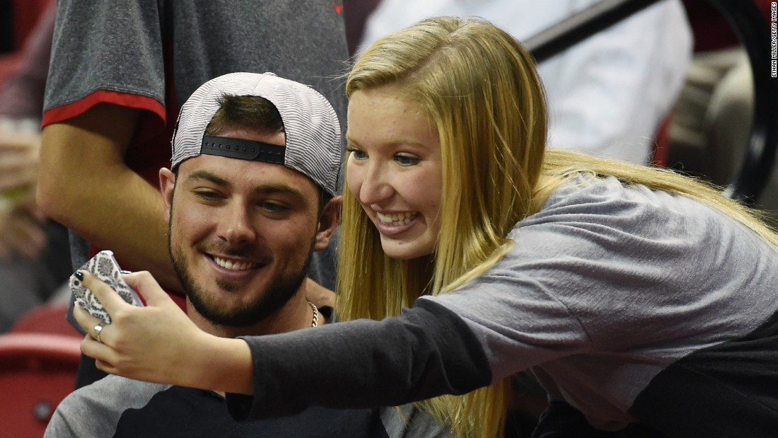 Baseball star Kris Bryant, the National League Rookie of the Year, poses for a selfie during a college basketball game in Las Vegas on Saturday, November 28.