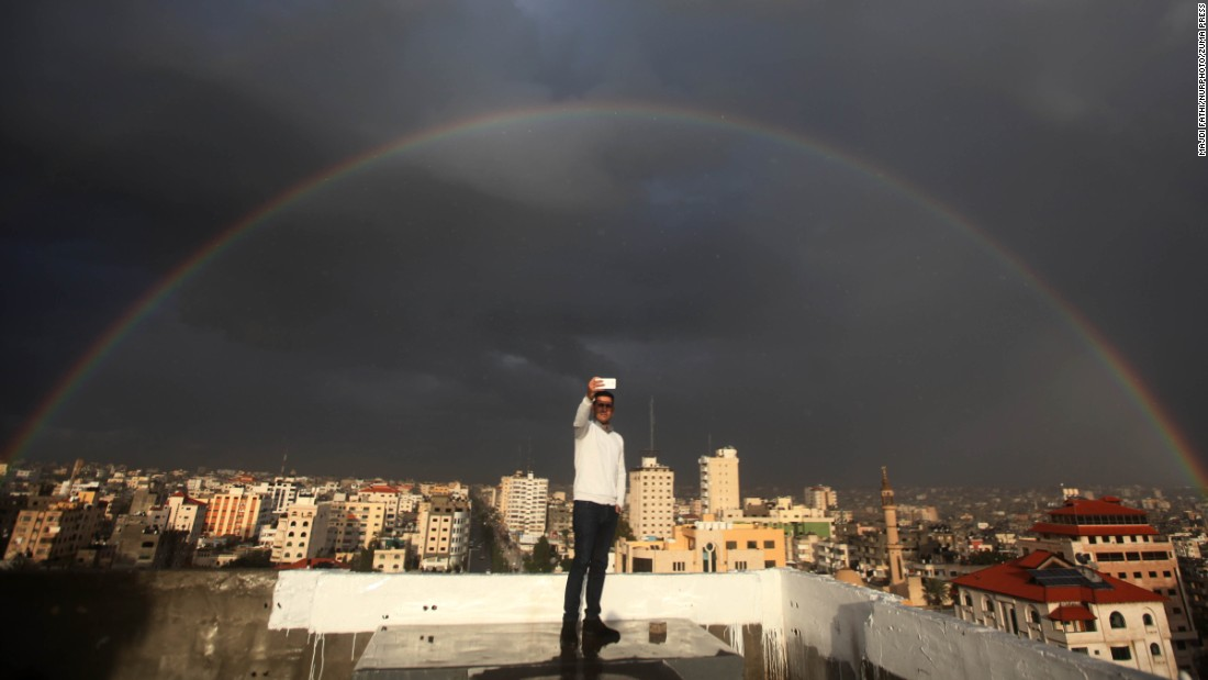 "A man takes a selfie as a rainbow shines over Gaza City on Tuesday, December 1. <a href=""http://www.cnn.com/2015/11/25/living/gallery/look-at-me-selfies-1125/index.html"" target=""_blank"">See 23 selfies from last week</a>"