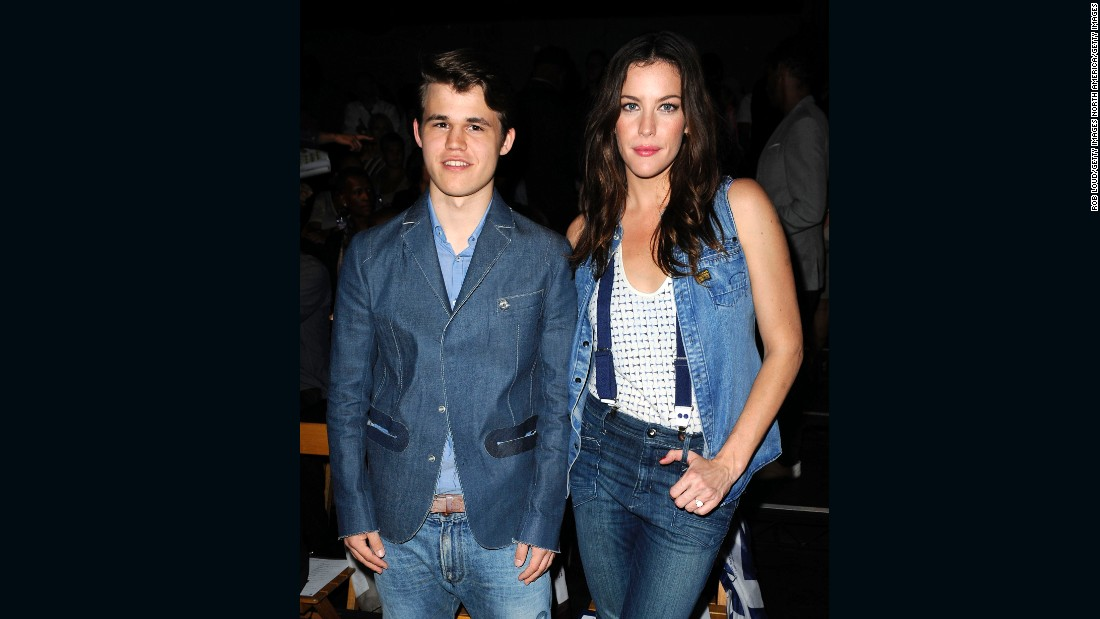 Carlsen is one of the most famous chess personalities the sport has seen in recent years. Here, he and actress Liv Tyler attend the G-Star Spring fashion show in New York, 2011.