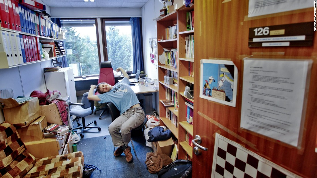 "At 19, Carlsen became the World No. 1. The teenager is pictured relaxing in his teacher's office, in 2009.<br />""My first trainer would sometimes give me some homework that I wouldn't really like -- sometimes I'd do it, sometimes I wouldn't,"" he says."