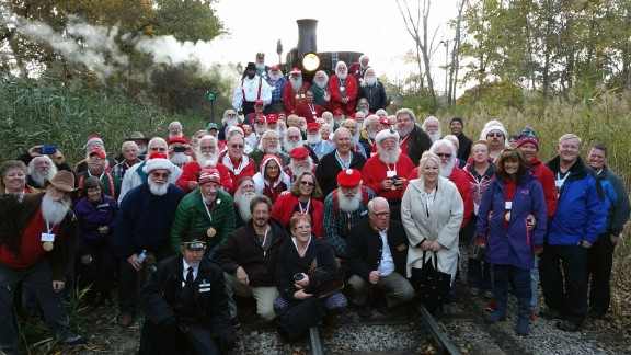 The 2015 Charles W. Howard Santa Claus School participants pose for a photo at Huckleberry Railroad.