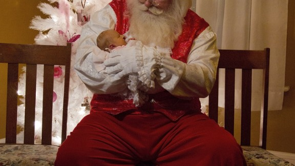 Santa Rick holds Hailey Green a few hours before she passes away.