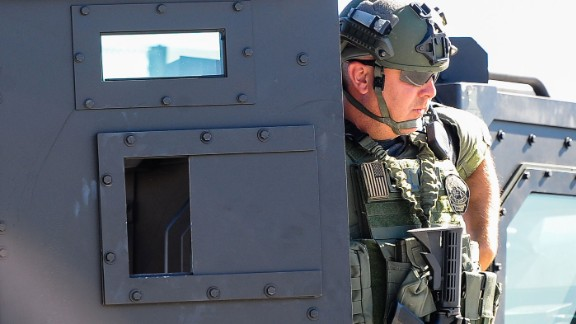 Heavily armed law enforcement officers swarmed the area where the shooting occurred.