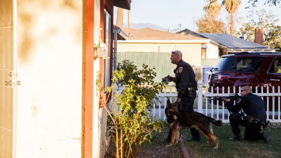 Police search for the suspects in San Bernardino.