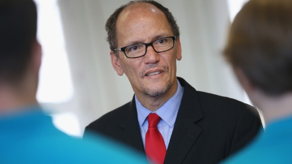U.S. Labor Secretary Thomas Perez chats with trainees at the Siemens training facility on October 28, 2014, in Berlin.