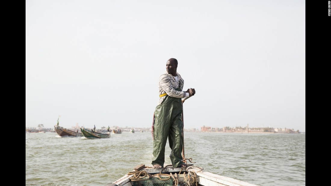 This past March, Greta Rybus spent a month working on a photo series in Saint-Louis, Senegal. This photo shows Aye Sarr at the helm of his large, wooden fishing boat. Most fishermen live in Guet Ndar, an overpopulated area coping with rising sea levels.