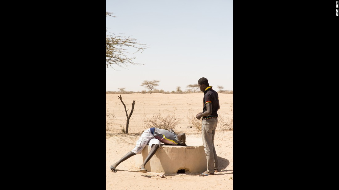 People living both on the coastline and inland have a strong relationship with and awareness of their environment. In this photo, two men look into a well, which was discovered to be too salty for farm use.