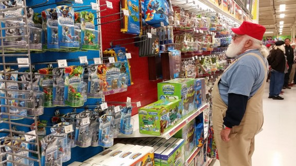 A Santa-in-training wanders the aisles at Toys R Us in Saginaw, Michigan.