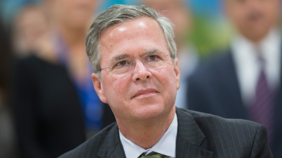 Republican presidential candidate Jeb Bush listens as Wisconsin Governor Scott Walker speaks at La Casa de Esperanza during a campaign stop the governor made with Bush on November 9, 2015 in Waukesha, Wisconsin.