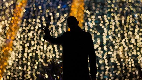 President Obama waves after lighting the National Christmas Tree.
