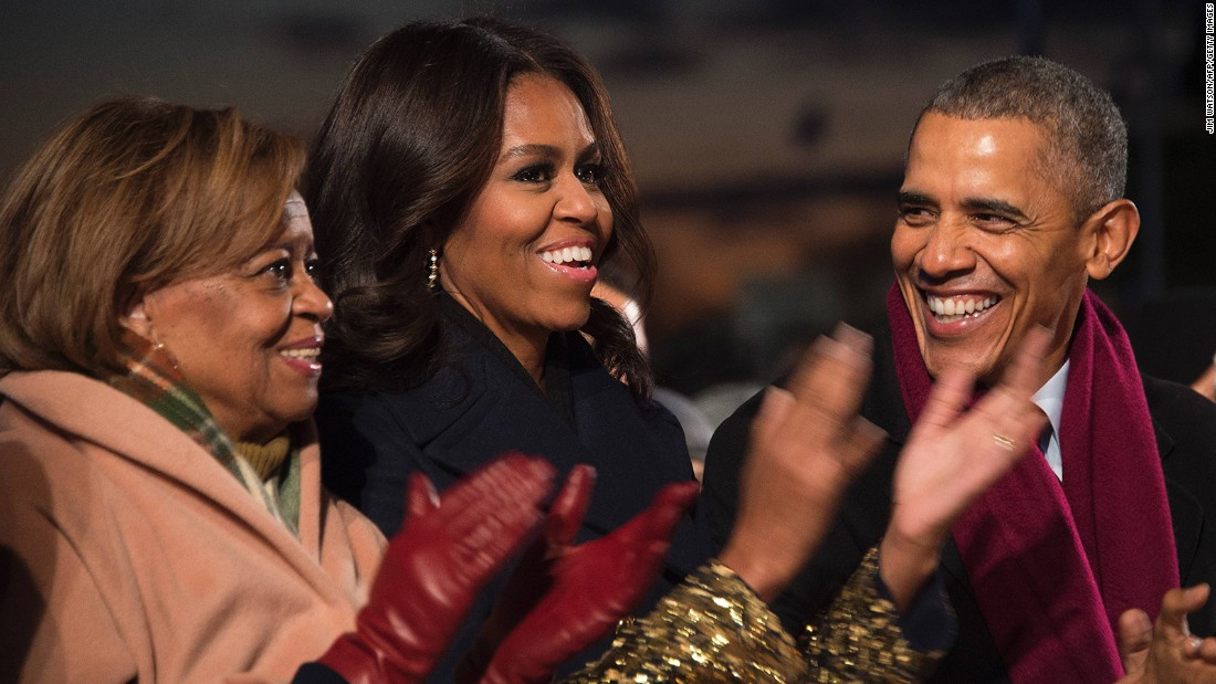 The President, first lady and her mother, Marian Robinson, laugh outside the White House.
