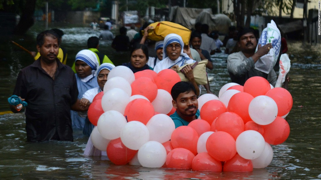 Residents walk through flood waters in Chennai, December 3.