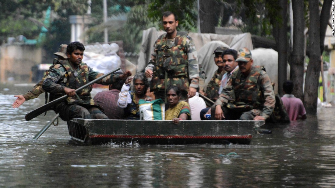 Indian army personnel use a boat to rescue residents from flood waters in Chennai on December 3.