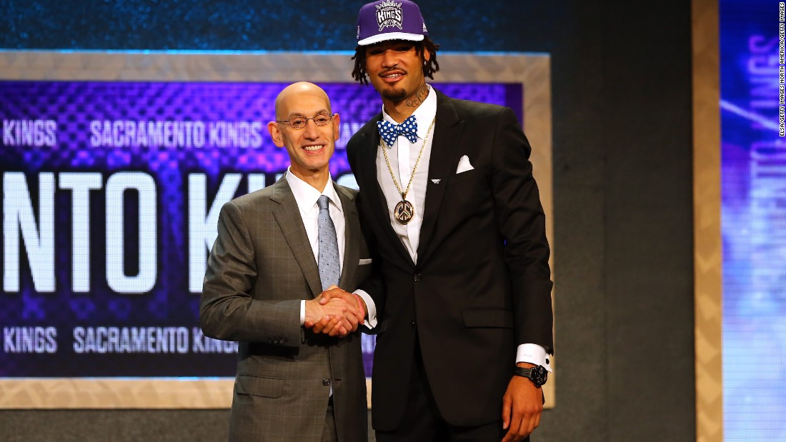 Seven-footer Willie Cauley-Stein goes with a bow tie and peace-sign pendant as he poses with Silver after being selected sixth overall by the Sacramento Kings.