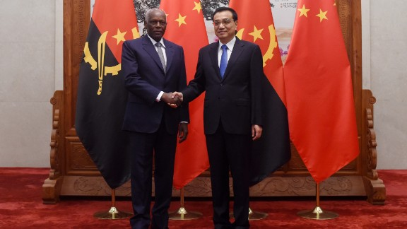 Angolan President Jose Eduardo Dos Santos shakes hands with Chinese premier Li Keqiang before their meeting in Beijing, June, 2015. Angola is Africa