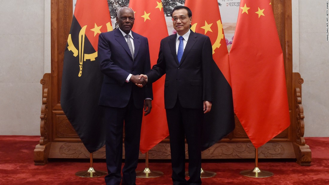 Angolan President Jose Eduardo Dos Santos (L) shakes hands with Chinese premier Li Keqiang (R) before their meeting at the Great Hall of the People in Beijing on June 9, 2015.   Angola is Africa's second largest oil producer, and their biggest buyer is China.