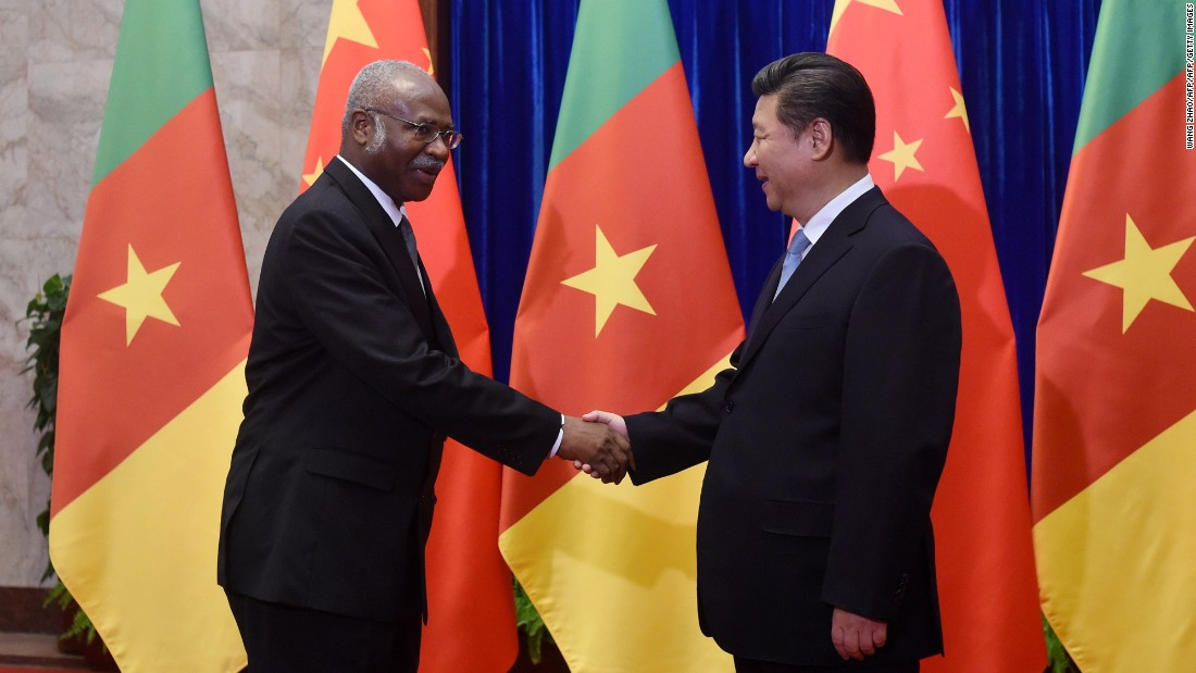 Cameroon Prime Minister Philemon Yang (L) shakes hands with Chinese President Xi Jinping (R) before their meeting at the Great Hall of the People in Beijing on June 19, 2015.  China  invested $3billion to Cameroon in 2011 towards the Memve'ele Dam project in the south of the country.