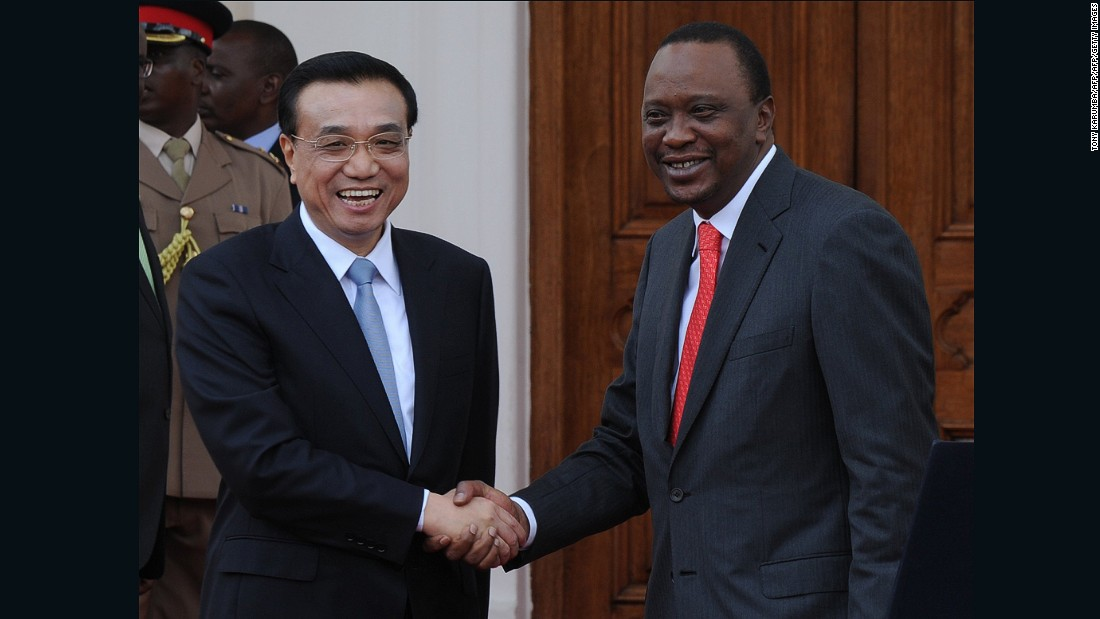 China's Premier, Li Keqiang (L) shakes hands with Kenyan President, Uhuru Kenyatta on May 10, 2014 at State House in the capital, Nairobi. Premier Li Keqiang arrived in Nairobi the day before on the final leg of a four-nation Africa tour, in a visit expected to boost trade, transport links and conservation and his first since taking office, with the world's second-biggest economy keen to boost its presence on the continent to find new markets and opportunities.