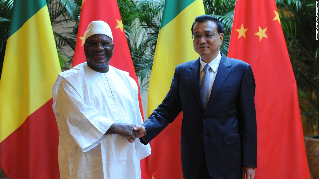 Malian President Ibrahim Boubacar Keita (L) shakes hands with Chinese Premiere Li Keqiang (R) during the World Economic Forum in Tianjin in 2014.  More recently, China has pledged to assist security operations in Mali, following an Islamist attack on a hotel in the capital Bamako in Novermber 2015.  Three Chinese nationals, who worked for the state run China Railway Construction Corp, were killed.