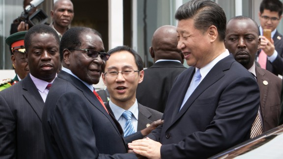 China's President Xi Jinping shakes hands with Zimbabwe's President Robert Mugabe as he arrives in Harare in December, 2015. The Chinese president  visited Zimbabwe despite criticism against the regime.