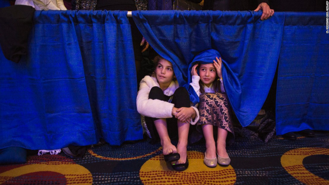 Zoey Verbesey, 10, of McLean, Virginia, and her friend, Catherine Dooley, 9, of Washington, listen at a fundraiser and endorsement event with female senators for Democratic presidential candidate Hillary Clinton at the Hyatt Regency on Capitol Hill on Monday, November 30.