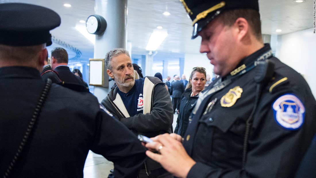 U.S. Capitol Police ask comedian Jon Stewart to leave the Senate subway area in the Capitol on Thursday, December 3, as he lobbies lawmakers to approve the extension of the James Zadroga Act. Stewart was on Capitol Hill along with New York first responders to call on Congress to fully fund programs that provide health care and compensation to 9/11 first responders and survivors. <br />