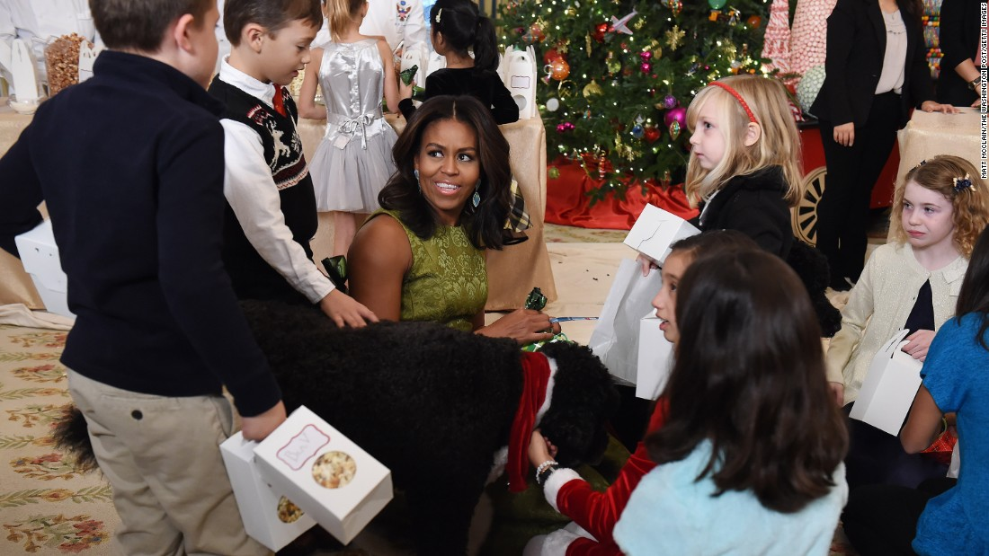 First Lady Michelle Obama talks to children in the State Dining Room at the White House on Wednesday, December 2, in Washington.