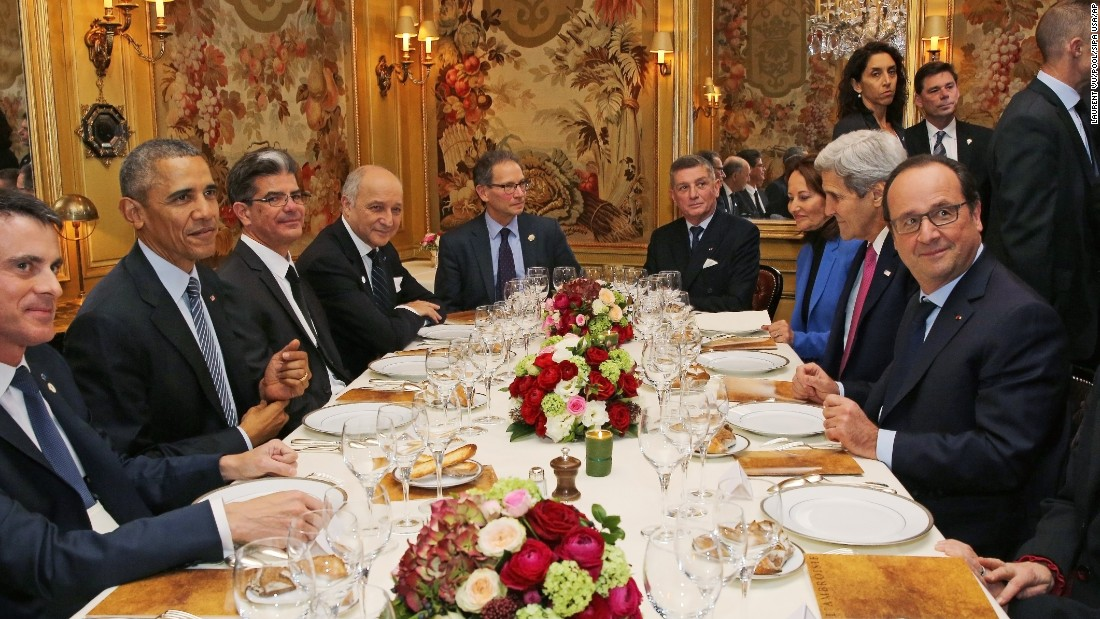"President Barack Obama, second left, and French President Francois Hollande, right, have dinner at L'Ambroisie restaurant in Paris, with U.S. Secretary of State John Kerry, second right, and others, as part of the COP21 World <a href=""http://www.cnn.com/2015/11/29/europe/france-paris-cop21-climate-change-conference/"" target=""_blank"">Climate Change Conference</a> in Le Bourget, north of Paris, on Monday, November 30."
