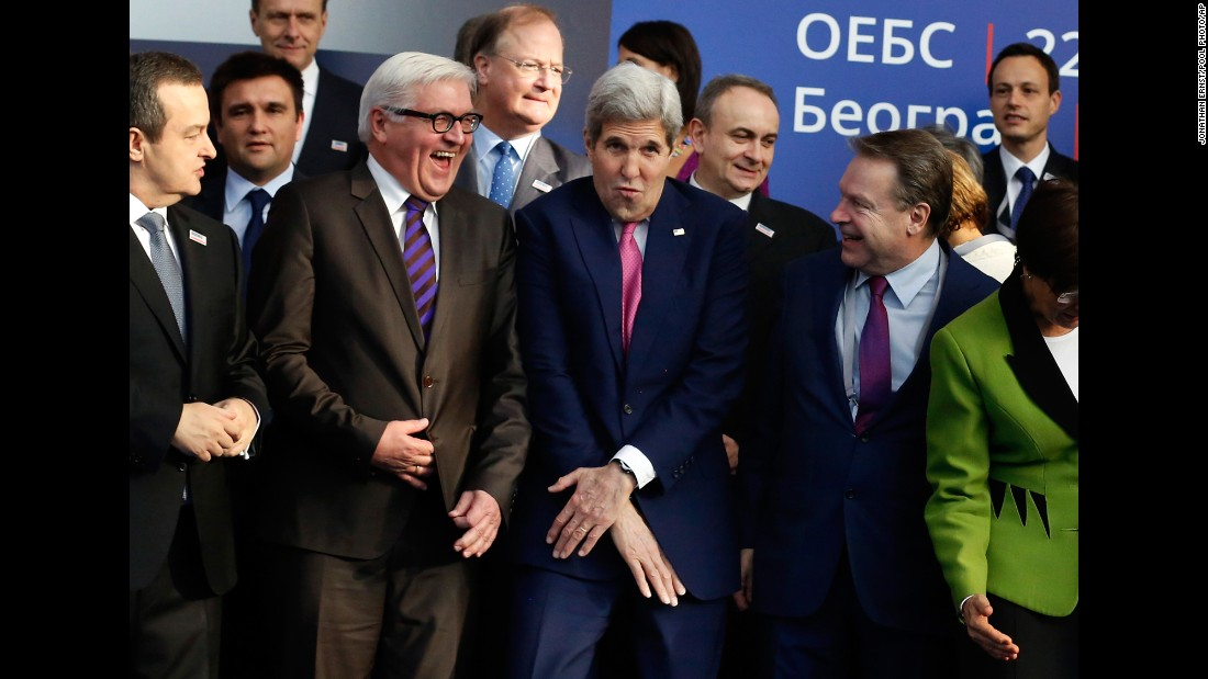 U.S. Secretary of State John Kerry, center, reacts to squeezing into a tight spot as he joins fellow diplomats for a OSCE Ministerial Council group photo in Belgrade, Serbia, on Thursday, December 3. Foreign ministers attended the opening session at the Organization for Security and Cooperation in Europe summit.