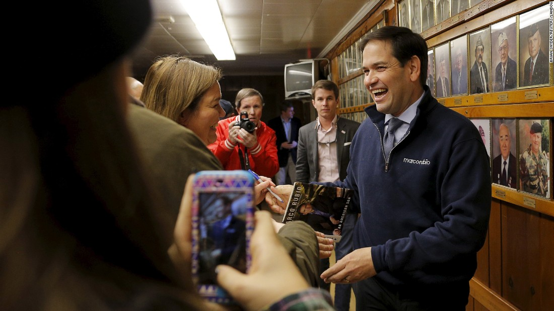 U.S. Republican presidential candidate and Senator Marco Rubio is greeted as he arrives at a campaign town hall meeting in Laconia, New Hampshire, on Monday, November 30.