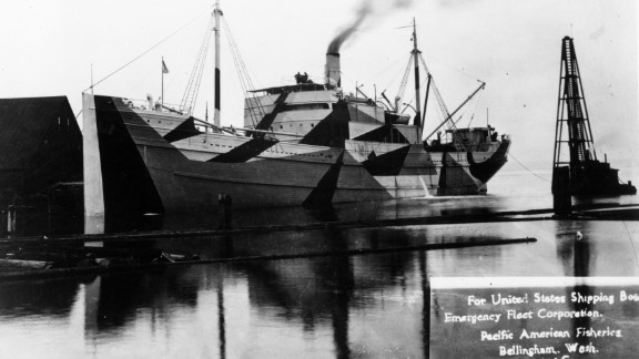"""A wooden ship built for the U.S. Shipping Board Emergency Fleet Corporation in Bellingham, Washington. The majority of wooden boats constructed never saw war service. Most were sold for salvage and then burned and sunk. This particular boat was painted with """"dazzle"""" camouflage."""
