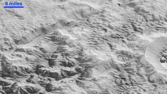 This image shows how erosion and faulting has sculpted Pluto's icy crust into rugged badlands. The prominent 1.2-mile-high cliff at the top is part of a great canyon system that stretches for hundreds of miles across Pluto's northern hemisphere, NASA says. Learn more at NASA.gov.
