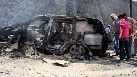 Yemenis check the scene of a car bomb attack Sunday, December 6, in Aden, Yemen. Aden Gov. Jaafar Saad and six bodyguards died in the attack, for which the terror group ISIS claimed responsibility.
