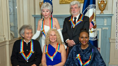 From left: Seiji Ozawa, Rita Moreno, Carole King, George Lucas and Cicely Tyson pose for a group photo after a dinner in their honor.