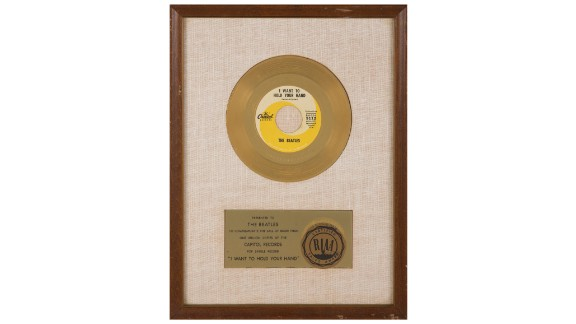 """This framed gold record award was presented to the Beatles to commemorate 1 million sales of """"I Want To Hold Your Hand."""" It sold for $68,750."""